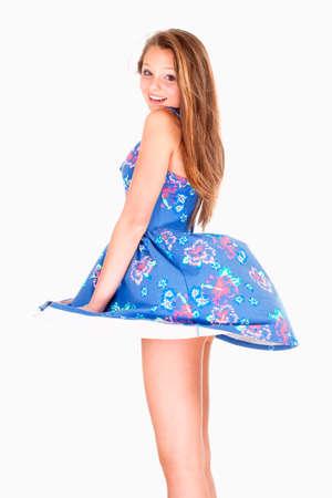 夏ドレス風を持ち上げると 10 代の少女 - 彼女のスカートは、白で隔離されます。