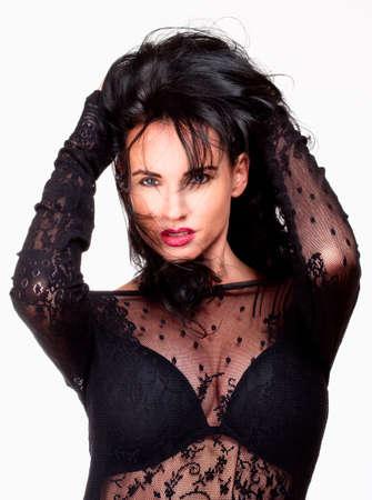 Vrouw met zwart haar in Sexy See-Through Dress - Geïsoleerd op wit Stockfoto