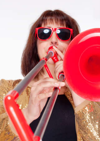 Young Female Musician Playing Trombone - Isolated on White