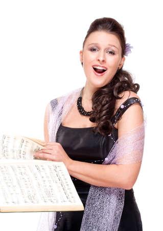 彼女のステージ ドレス - 白で隔離されるオペラ歌手