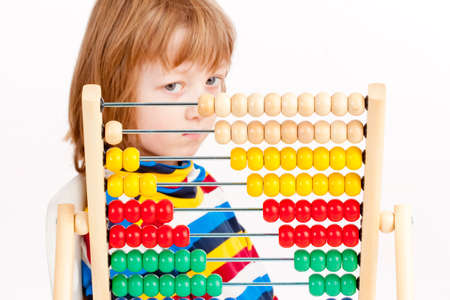 Boy Looking at Colorful Wooden Abacus Thinking - Isolated on White Stok Fotoğraf