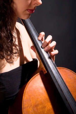 violoncello: Closeup of a Female Musician Playing Violoncello Stock Photo