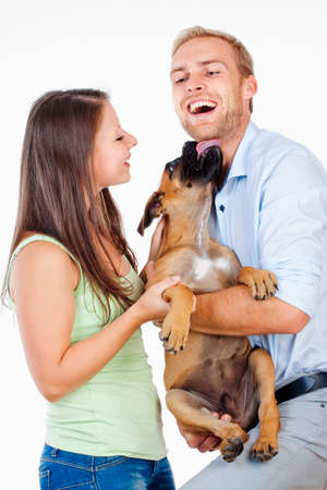 Portrait of a Happy Young Couple with a Dog. photo