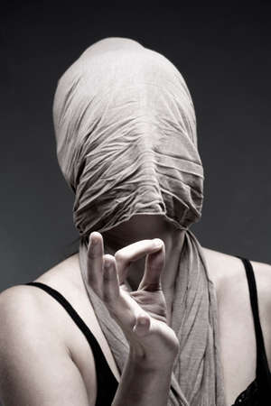 hand sign: Woman Covering Face with Cloth, Making Hand Sign with Fingers