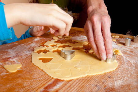 christmas baking: Traditional Czech Christmas Baking - Shaping Dough with Forms Stock Photo