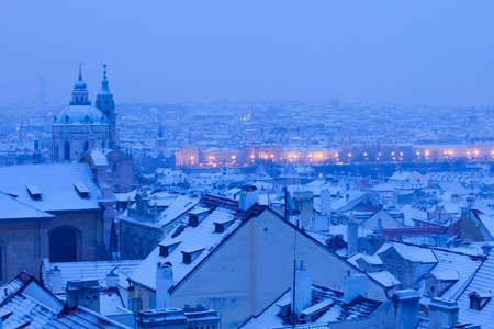 Prague - St. Nicolas church and rooftops of Mala Strana in winter photo