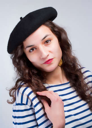 Young Beautiful Woman with French Style Beret and Striped T-Shirt Stock Photo