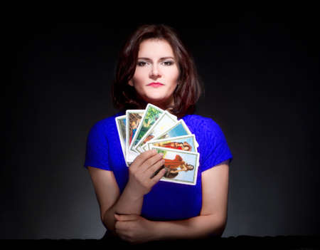 psychic reading: Woman in Blue Dress Holding Tarot Cards