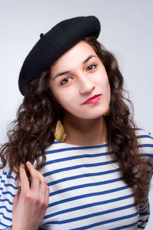 Young Woman with French Style Beret Hat and Striped T-shirt
