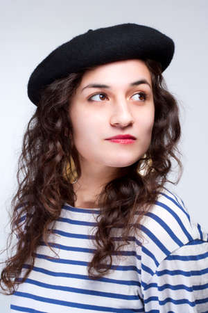 barrett: Young Woman with French Style Beret Hat and Striped T-shirt