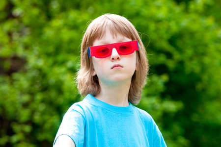 funny glasses: Portrait of a Boy with Funny Red Glasses Looking