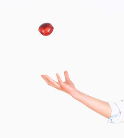 tossing: Hand Tossing Red Apple in the Air Stock Photo