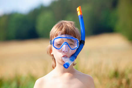 fitting in: Boy Fitting in Breathing Tube before Snorkeling