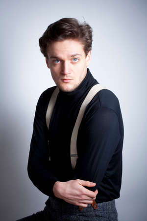 suspenders: Portrait of a Young Man with Brown Hair with Suspenders. Stock Photo