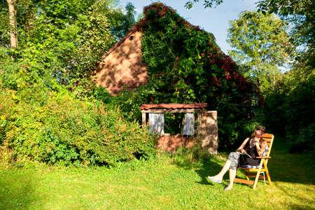 novel: Woman Reading a Book in the Garden