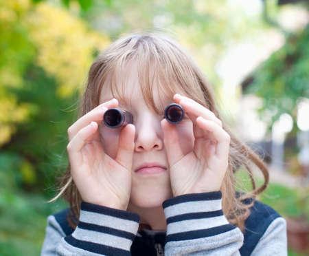 see through: Boy Looking Through Tubes as Binoculars Outdoors