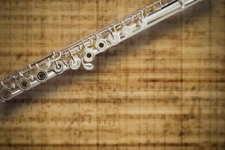 Flute Middle Joint/solid silver/ On MUSIC Sheet Background Stock Photo - 9655572