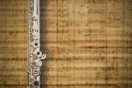Flute Middle Jointsolid silver On MUSIC Sheet Background