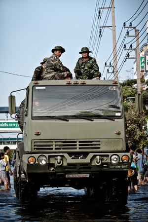 BANGKOK - NOVEMBER 13: A military truck carries a group of officers to help people from the flooded area at Sapan Mai district during the massive flood crisis on November 13, 2011 in Bangkok.