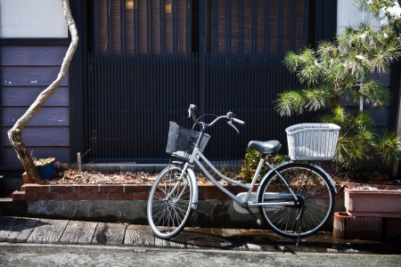 Old Bicycle in front of a Japanese House  photo