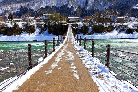 Bridge to Gassho-zukuri Village Shirakawago  photo