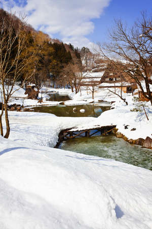 Small Canal Surrounded with Snow at Gassho-zukuri Village Shirakawago photo