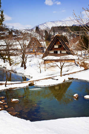 Small Swamp Surrounded with Snow at Gassho-zukuri Village Shirakawago photo