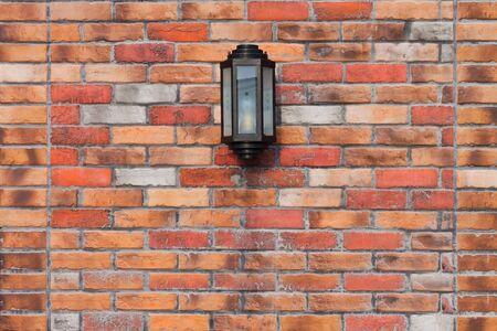 Lamp on a Brick Wall photo
