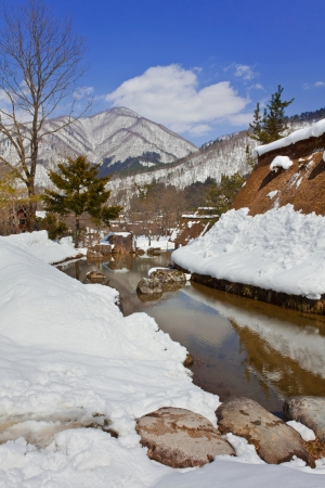 Canal Surrounded with Snow at Gassho-zukuri Village Shirakawago photo