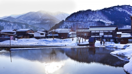 gassho zukuri: SHIRAKAWA GO, JAPAN - MARCH 27  Declared a UNESCO world heritage site in 1995,  their traditional Gassho-zukuri farmhouses, some are more than 250 years old on March 27, 2012 in Shirakawa Go, Japan