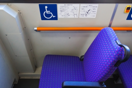 reserved seat: KANAZAWA, JAPAN - MARCH 28   A reserved seat for handicapped person on a Kanazawa loop bus that routed from Kanazawa station to all historic sites on March 28, 2012 in Kanazawa, Japan