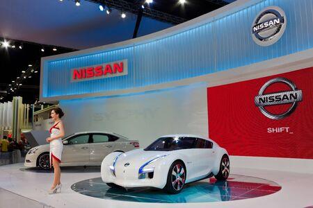 introduces: BANGKOK, THAILAND - DECEMBER 4  Zero Emission, in Bangkok, Thailand on December, 2012  Unidentified female presenter introduces Nissan Zero Emision concept at THAILAND INTERNATIONAL MOTOR EXPO 2012