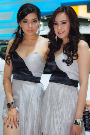 BANGKOK, THAILAND - DECEMBER 4  Chevrolet Pavillion, in Bangkok, Thailand on December, 2012  Unidentified female models at Chevrolet Pavillion in THE 29th THAILAND INTERNATIONAL MOTOR EXPO 2012  Stock Photo - 16680036