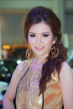 importer: BANGKOK, THAILAND - DECEMBER 4  TSL pavilion, in Bangkok, Thailand on December, 2012  Unidentified female model at TSL  grey market importer  booth in THE 29th THAILAND INTERNATIONAL MOTOR EXPO 2012