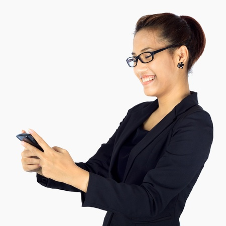 recieving: Isolated young happy business woman recieving a short message