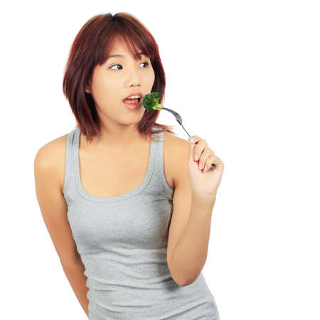 brocolli: Isolated young asian woman with a picec of brocolli Stock Photo