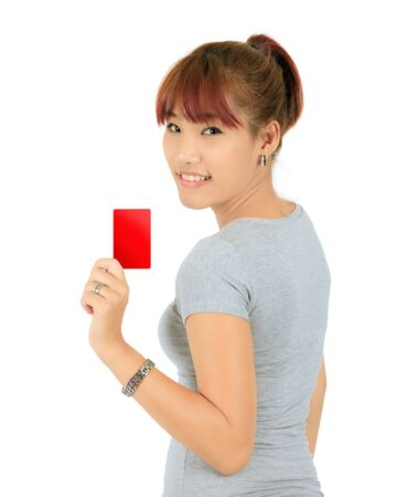 Isolated Young Asian Woman With a Credit Card Stock Photo - 17336690