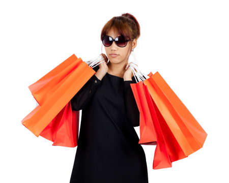 Isolated young asian woman carries shopping bags Stock Photo - 17336683