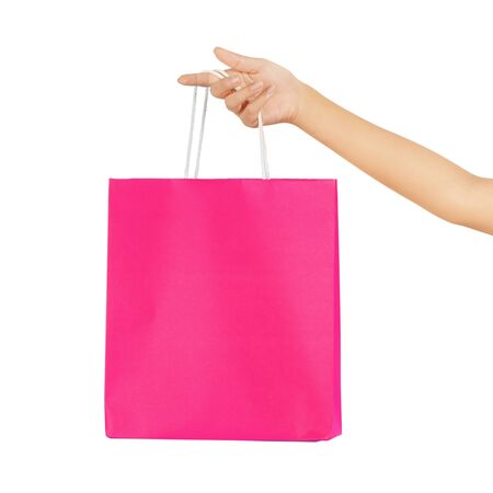 Isolated woman hand carries a shopping bag Stock Photo