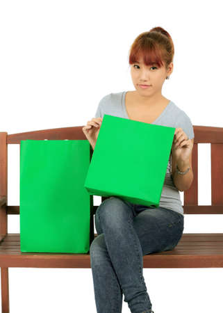 Isolated Young Asian woman with Green Shopping Bags Stock Photo - 17415925