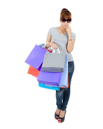Isolated Yong Asian Woman With colorful Shopping Bags Stock Photo - 17415929