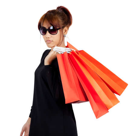 Isolated young asian woman carries shopping bags Stock Photo - 17415932