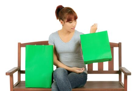 Isolated Young Asian woman with Green Shopping Bags Stock Photo - 17642006