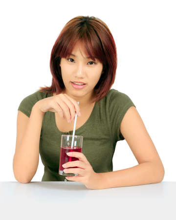 and grape juice: Isolated young asian woman with a cglass of grape juice