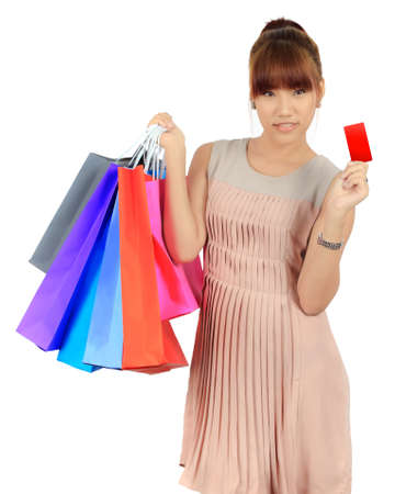Isolated Young Asian Woman With colorful Shopping Bags Stock Photo - 18180122