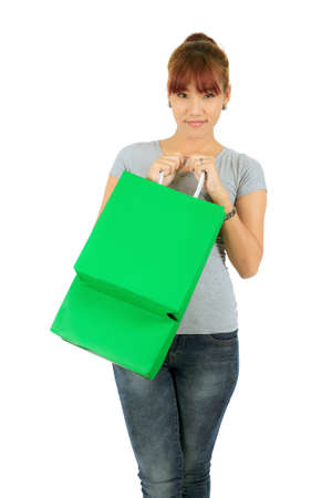 Isolated Young Asian woman with Green Shopping Bags Stock Photo - 18286202