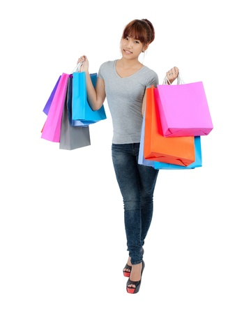 Isolated Yong Asian Woman With colorful Shopping Bags Stock Photo - 18444051