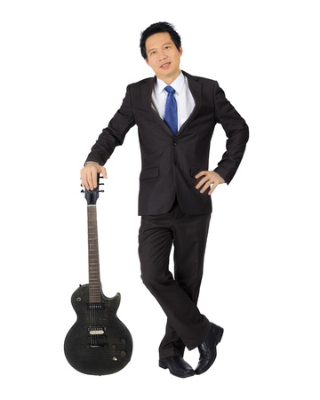 An asian man with a black electric Guitar photo