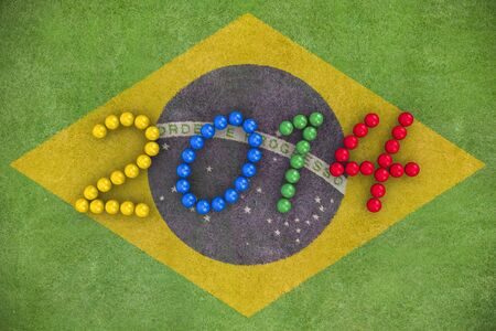 3D rendering of footballs form in to the year 2014 over a Brazil flag painted on a grass field Stock Photo - 18845798