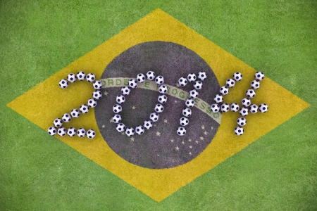 3D rendering of footballs form in to the year 2014 over a painted grass field of Brazil Flag photo
